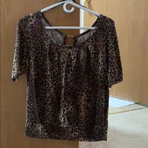 Leopard print shirt with gold detailing on back.